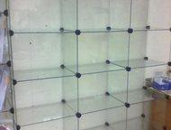 Стеклянный стеллаж Продаю стеклянный стеллаж для товара по очень выгодной цене.