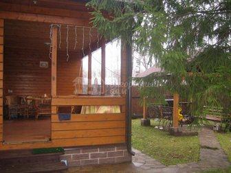 Смотреть foto Загородные дома Коттедж из клееного бруса на участке 15 соток в окружении леса 29371995 в Москве