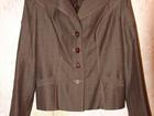 Уникальное изображение  Продам костюм «ГОТА» (пиджак и юбку), Костюм коричневый в продольную полоску, размер-46 38953665 в Находке