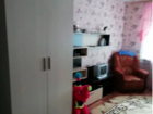 Продам уютную комнату, частично с мебелью.Пластиковое окно,
